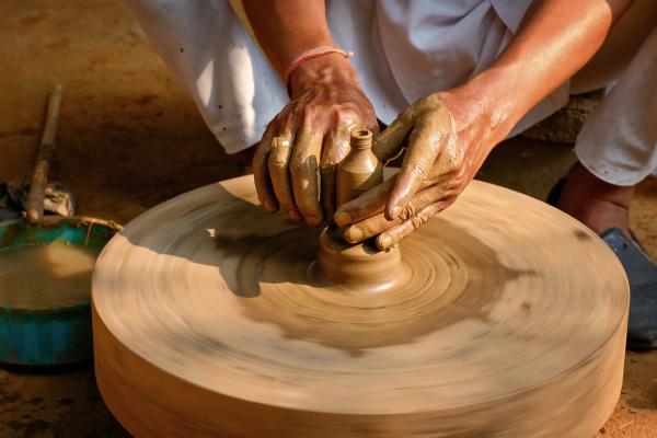 indian potter hands at work shilpagram