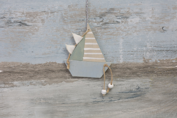 decorative sailboat on wooden background