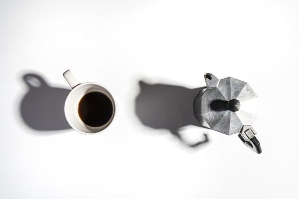 a cup and a coffee pot