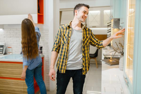 couple buying kitchen garniture in furniture