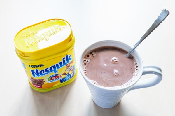 closed jar of nesquik and mug