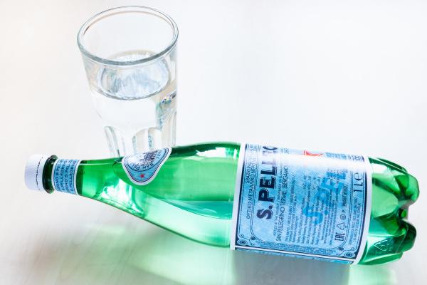lying bottle of s pellegrino water