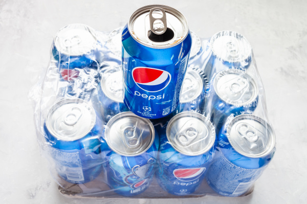 open can of pepsi over pack