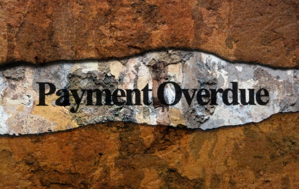 payment overdue text on wall