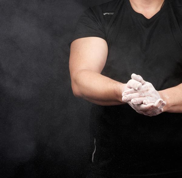 muscular athlete in a black uniform