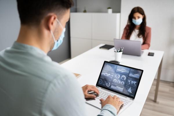 business employee meeting social distancing