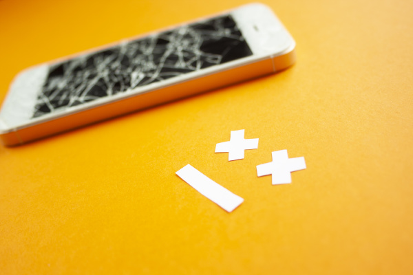 broken smartphone with cracked destroyed screen
