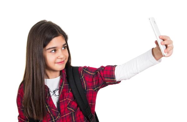 pretty school girl doing selfie