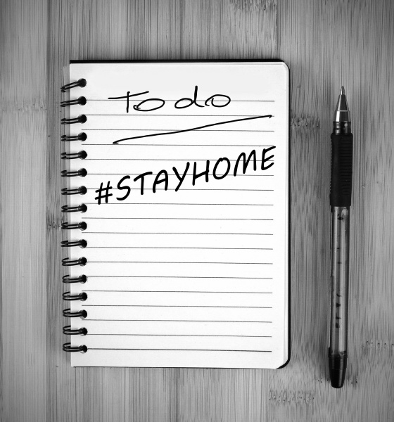 note paper saying stay at home