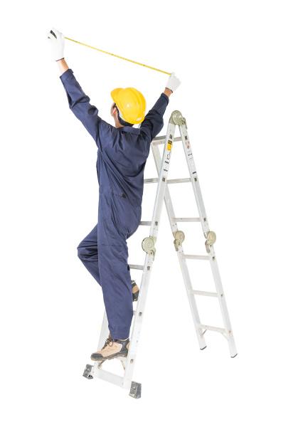 handyman in uniform standing on ladder