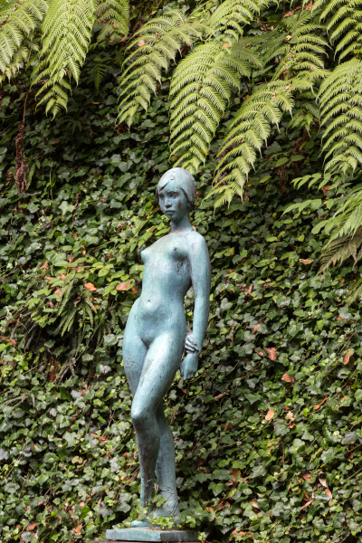statue of woman in botanical