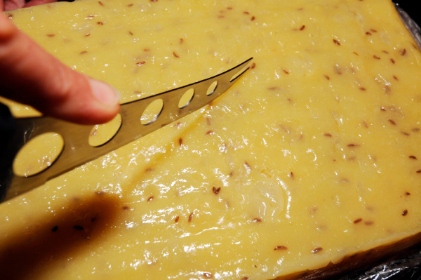 cutting cheese with a cheese knife