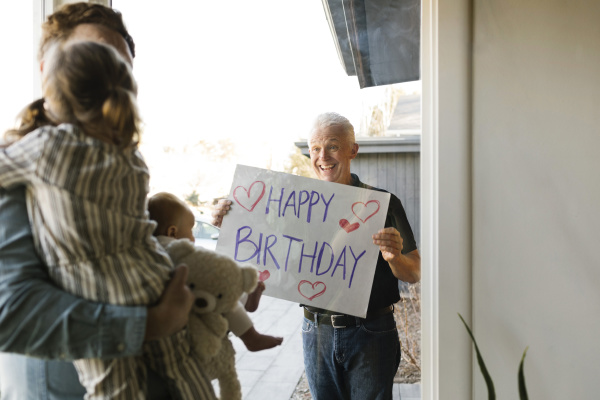 grandfather showing happy birthday message to