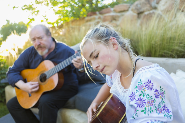 11 year old girl playing guitar
