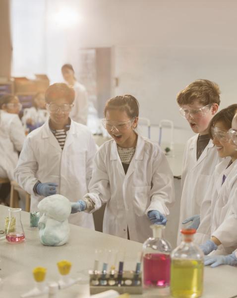 surprised students conducting exploding foam scientific