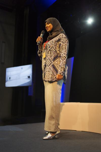 female speaker in hijab talking with