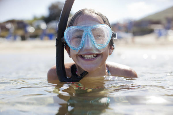 happy girl wearing snorkel and goggles