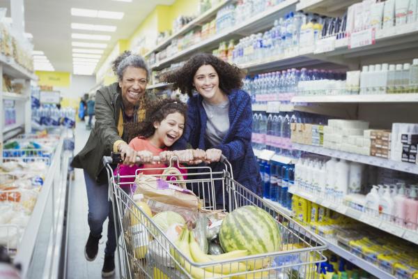 playful multi generation women pushing shopping
