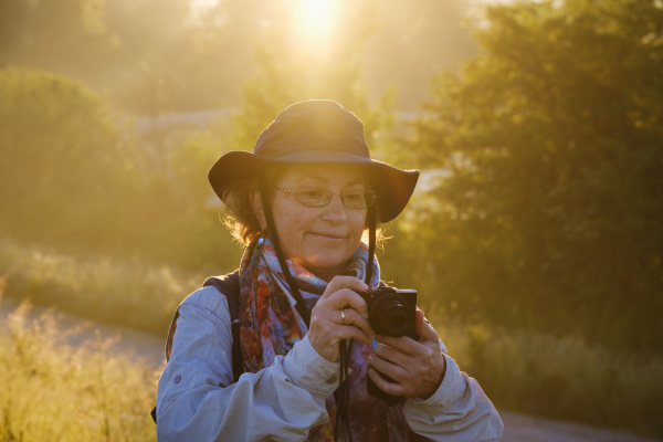senior female hiker looking at camera