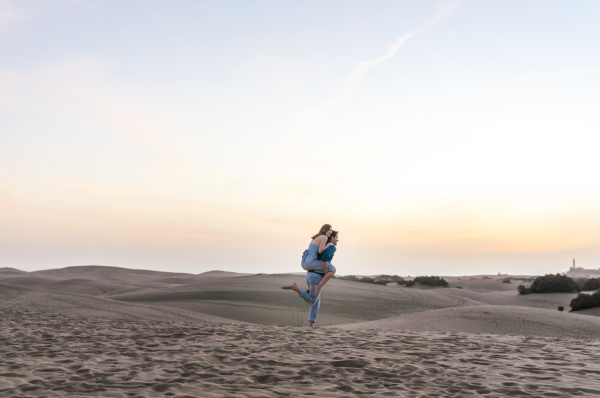 carefree couple at sunset in the