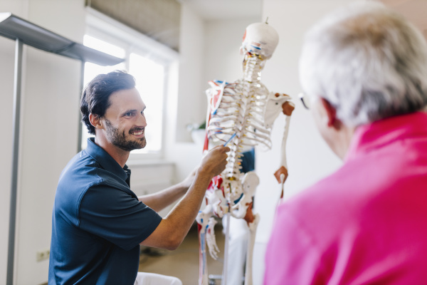 physiotherapist explaining treatment to patient using