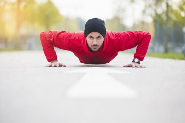young man doing push ups on