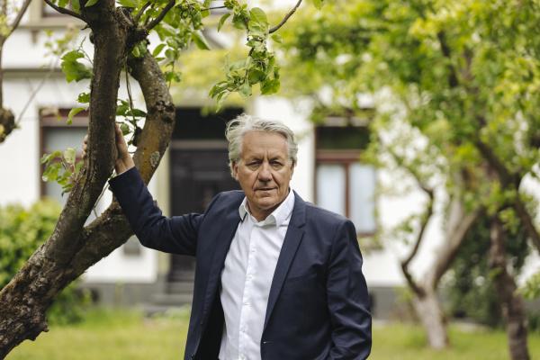 portrait of senior businessman standing at