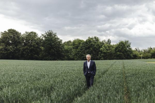 senior businessman on a field in