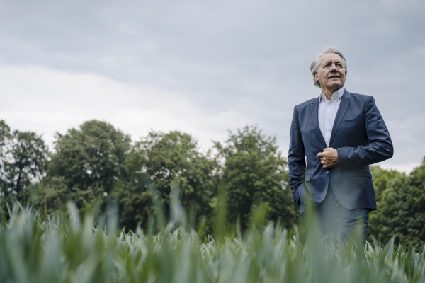 confident senior businessman on a field