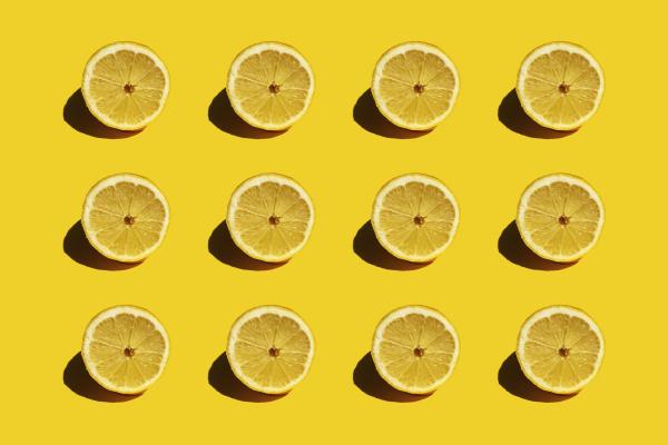 pattern of fresh halved lemons against