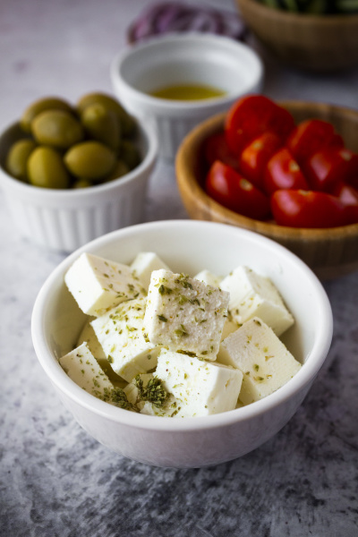 bowls with fresh ingredients for greek