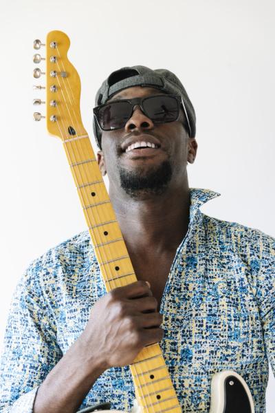 portrait of confident male guitarist holding