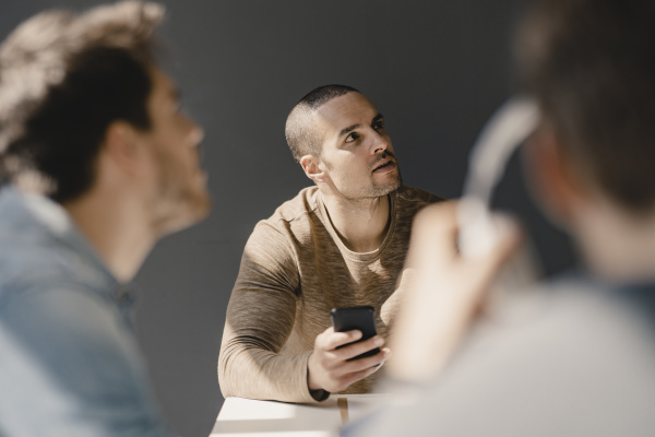 young entrepreneur in a meeting using