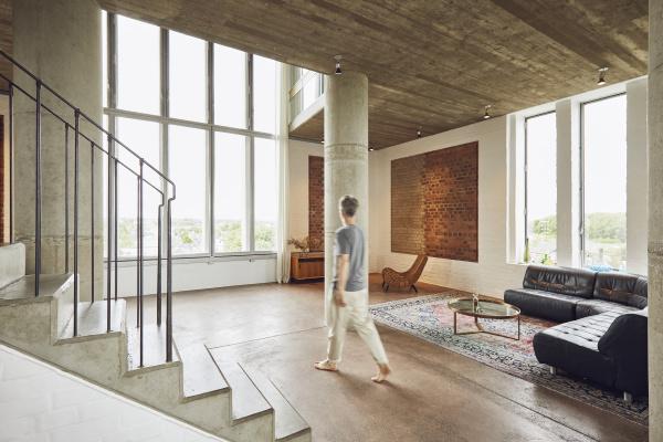man walking in a loft flat