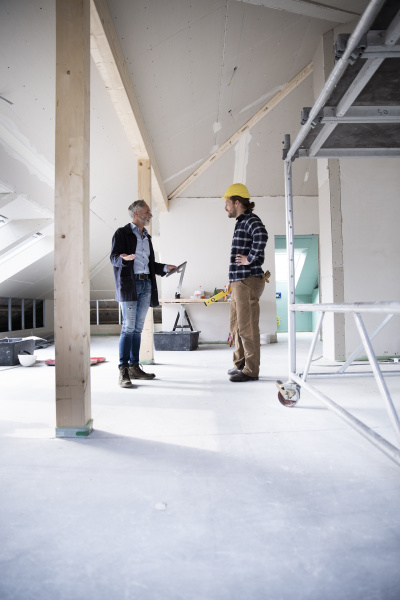 architect and construction worker planning while