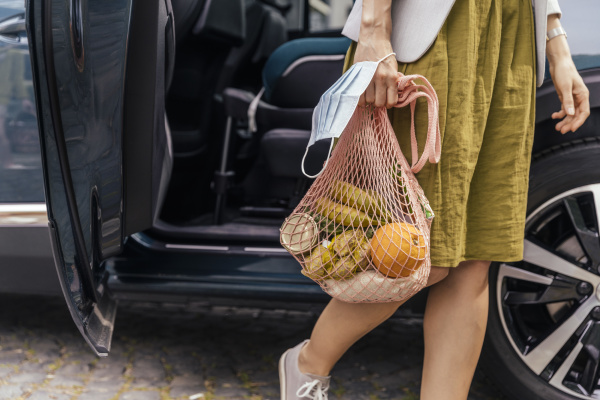 crop view of woman with purchase