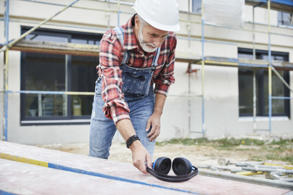 construction worker with ear muff working