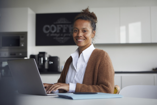 portrait of smiling businesswoman working on