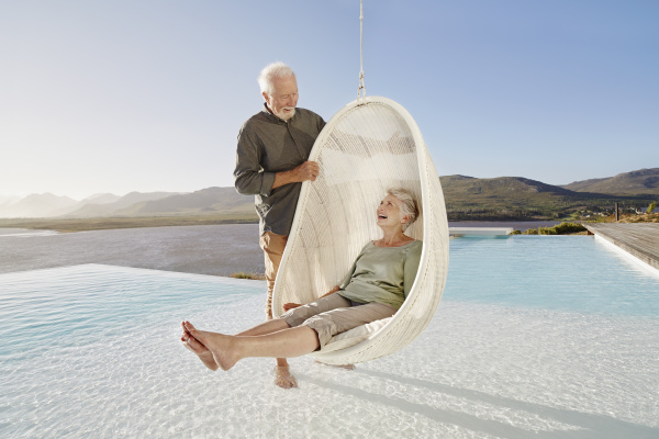 happy senior couple with woman sitting