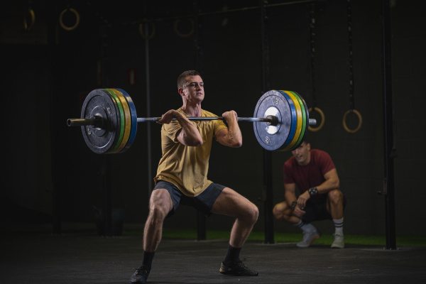 man doing overhead squat exercise at