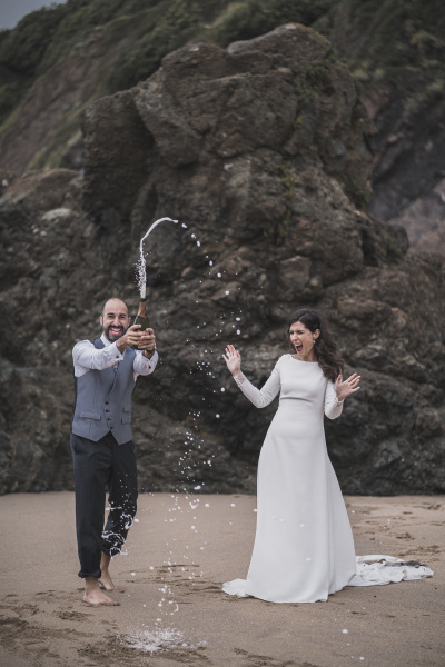 bridal couple man splashing with