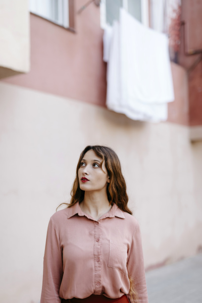 portrait of young woman wearing pink