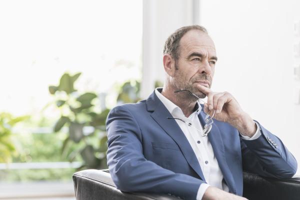 portrait of pensive businessman sitting in