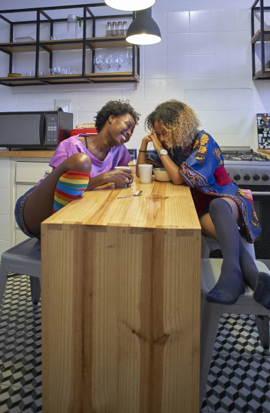 two happy women sitting in the