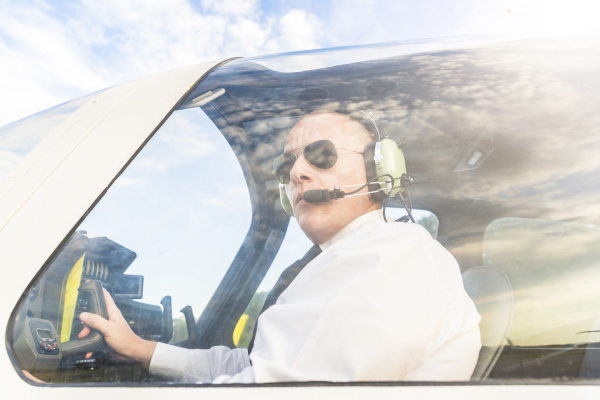 pilot with headset sitting in sports