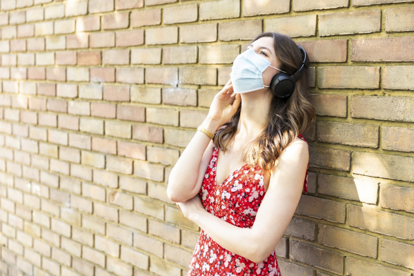 young woman wearing protective mask and