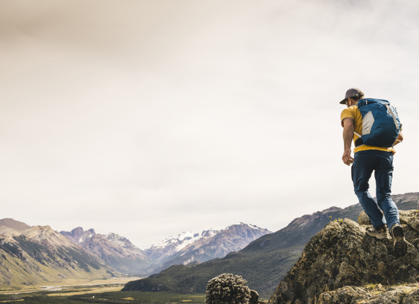mature hiker with backpack walking on