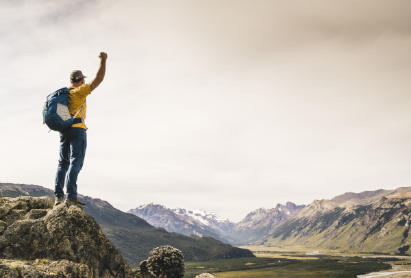 man with arm raised looking at