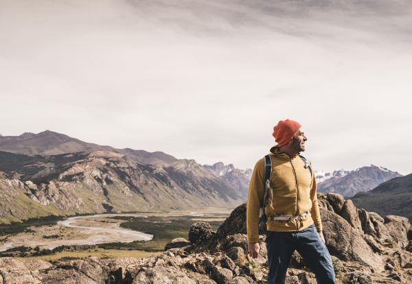 male hiker looking away while standing