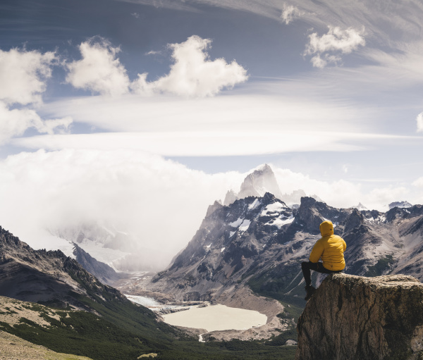 man looking at snowcapped mountain while